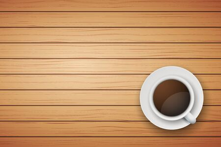 Top view of cup of coffee or tea on the table light wood with space for text