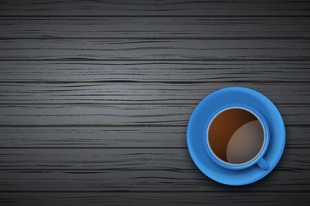 Top view of blue cup of coffee or tea on the table black wood with space for text