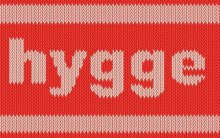 gefesselt: Wort HYGGE auf Strickerei Textur