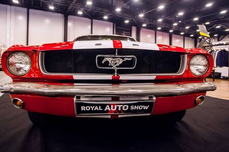 SAINT-PETERSBURG, RUSSIA - JULE 23, 2017: Front view of Classic Ford Mustang GT 390 on Royal Auto Show. Close up of Car hood and radiator with headlamp