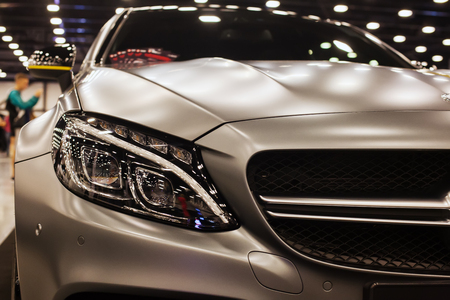 SAINT-PETERSBURG, RUSSIA - JULE 23, 2017: Front view of Mersedes-Benz AMG on Royal Auto Show. Close up of Car hood and radiator with headlamp