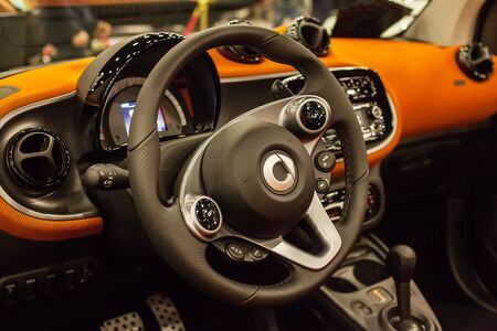 SAINT-PETERSBURG, RUSSIA - JULE 23, 2017: Car Interior of New Mersedes Smart Fortwo. Close up of Car steering wheel and dashboard panel. Editorial