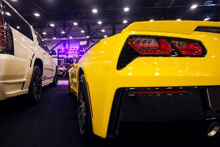 SAINT-PETERSBURG, RUSSIA - JULE 23, 2017: Back view of Yellow Chevrolet Corvette Stingray C7 on Royal Auto Show. Close up of Car trunk and backlight.