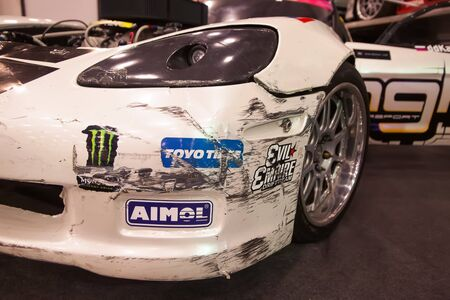 shiny car: SAINT-PETERSBURG, RUSSIA - JULE 23, 2017: Front view of racing car with broken and scratching bumper on Royal Auto Show. Close up of Car fender and headlamp.