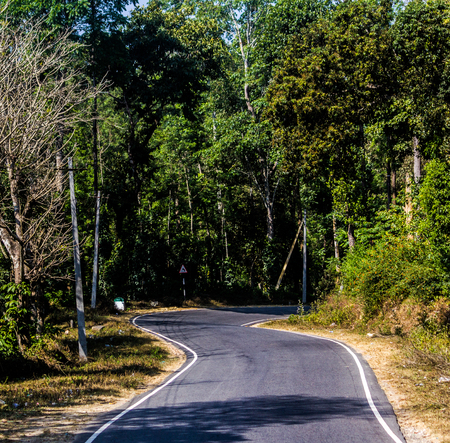 Empty roads often lead to beautiful destination 写真素材