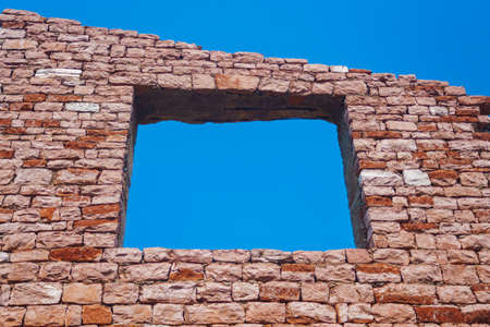 crack: window to the sky in old brick wall