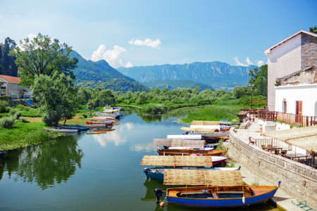 Lake Skadar National Park. Boats with a thatched roofs on the pier. Skadar lake tour