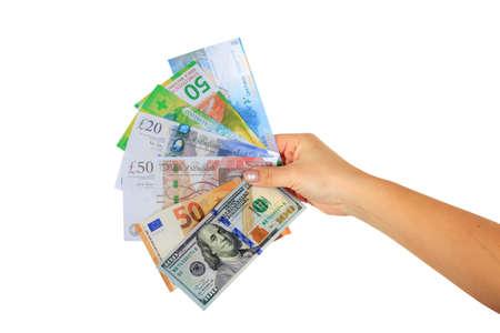 female hand holding paper banknotes dollars, Euro, Swiss franc and British pound horisontal isolated on white background