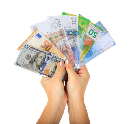 Female hands holding different money paper banknotes: 100usd, 50 euro, british pounds and Swiss francs isolated on white background. money fan Stock Photo