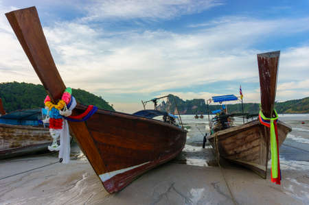 Thai long tail boats parking on the sand at low tide. Phi Phi Don island, Thailand Stock Photo