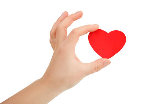 female hand holding small bright red heart on white background. Love, marriage, engagement, Valentines day concept
