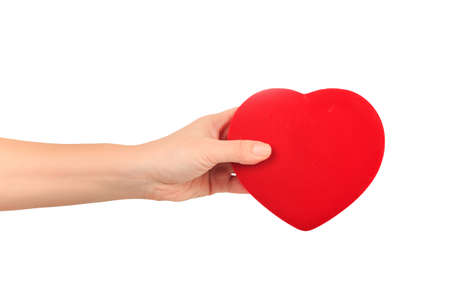 female hand holding big bright red heart on white background. Love, marriage, engagement, Valentines day concept