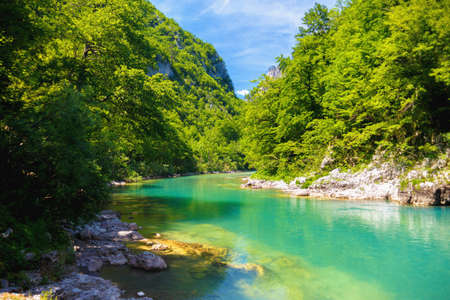 blue river flows in the picturesque mountains