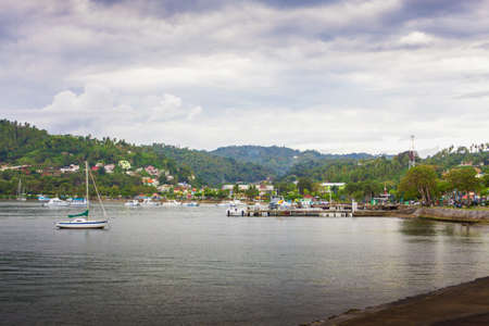 sail boats near the cost with palm trees in cloudy weather. Samana, Dominican Republic