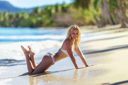 beautiful girl in bikini on tropical beach