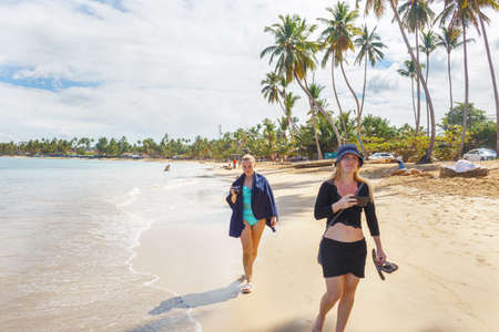 two girls walking on the tropical beach in Dominican Republic 写真素材