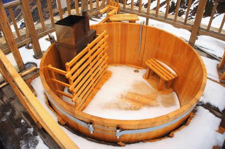 empty wood tub or chan in snowy day on ski resort