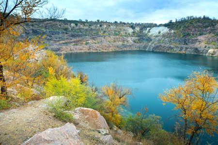 great radon blue lake, granite quarry in autumn, picturesque landscape, natural background