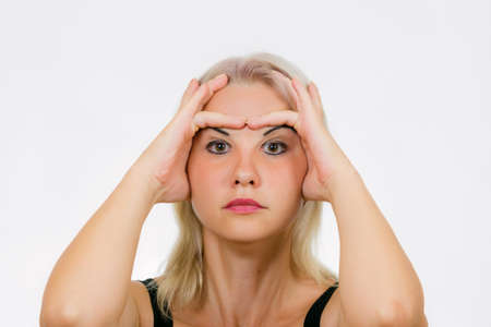 Face exercise for EYELIDS, woman lift her brows up and down with fingers