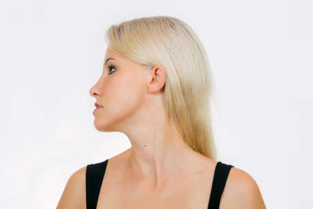 Face exercise, woman turn head to left and  shift bottom jaw close-up