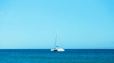 large touristic white catamaran at calm sea