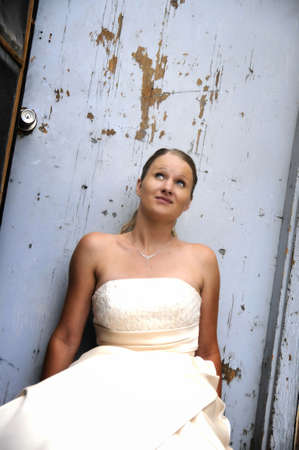 mood moody: close up of a woman in a wedding dress in a urban enviroment Stock Photo