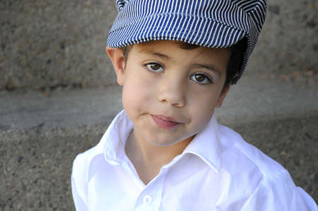 a yound child in a hat looking into the camera Stock Photo - 3621799