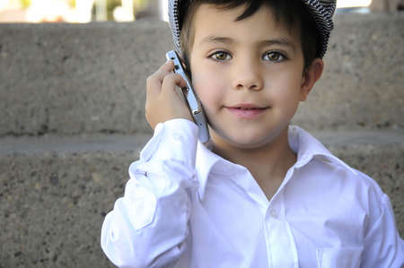 a young child talking on his cell phone photo