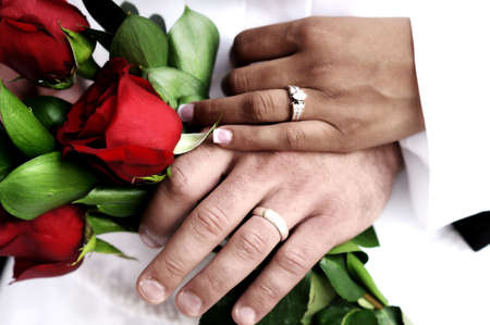 girl with rings: a couple showing off their wedding rings Stock Photo
