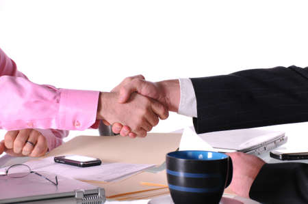 two business men shaking hands after a deal Stock Photo - 7657650