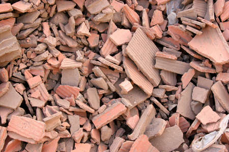 Rubble composed of red broken bricks in an old demolished building. Stock Photo - 574636