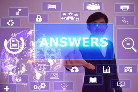 answers concept: ANSWERS concept  presented by  businessman touching on  virtual  screen , Stock Photo