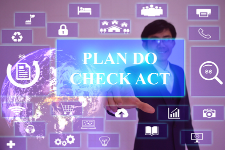 plan do check act: PLAN DO CHECK ACT concept  presented by  businessman touching on  virtual  screen ,