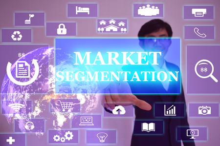categorize: MARKET SEGMENTATION concept  presented by  businessman touching on  virtual  screen ,image element furnished by NASA