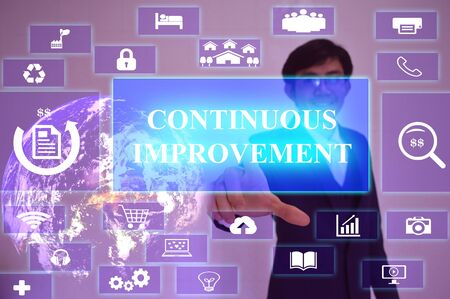 cip: CONTINUOUS IMPROVEMENT concept  presented by  businessman touching on  virtual  screen ,