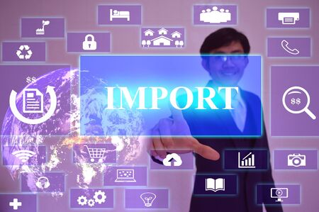importation: IMPORT concept  presented by  businessman touching on  virtual  screen ,image element furnished by NASA