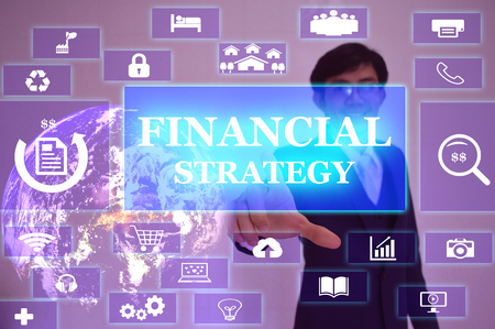 basic scheme: FINANCIAL STRATEGY concept  presented by  businessman touching on  virtual  screen ,image element furnished by NASA