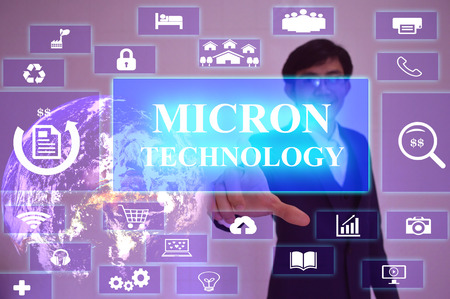 MICRON TECHNOLOGY  concept  presented by  businessman touching on  virtual  screen 版權商用圖片