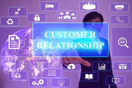 customer facing: CUSTOMER RELATIONSHIP  concept  presented by  businessman touching on  virtual  screen ,