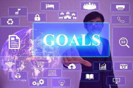 presented: GOALS concept  presented by  businessman touching on  virtual  screen , Stock Photo