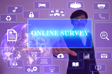 cause marketing: ONLINE SURVEY  concept  presented by  businessman touching on  virtual  screen ,