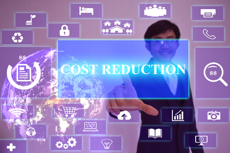 cost reduction: COST REDUCTION concept  presented by  businessman touching on  virtual  screen ,