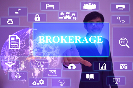 brokerage: BROKERAGE concept  presented by  businessman touching on  virtual  screen ,
