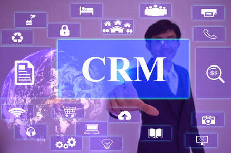 relationship management: CRM - Customer Relationship Management concept  presented by  businessman touching on  virtual  screen ,