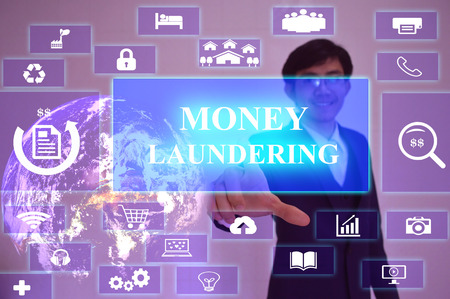 legitimate: MONEY LAUNDERING  concept  presented by  businessman touching on  virtual  screen
