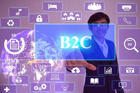 b2c: B2C  concept  presented by  businessman touching on  virtual  screen