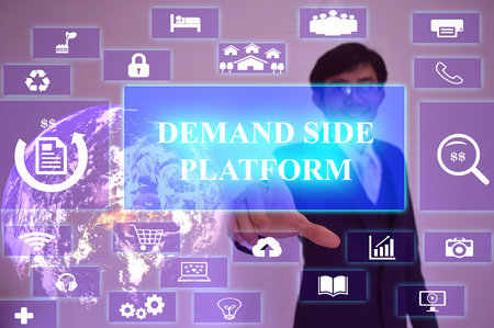 in demand: DEMAND SIDE PLATFORM concept  presented by  businessman touching on  virtual  screen