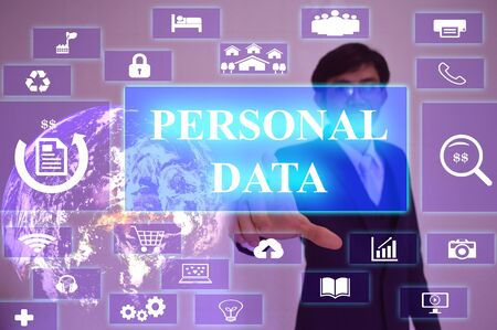 personal element: PERSONAL DATA  concept  presented by  businessman touching on  virtual  screen ,image element furnished by NASA