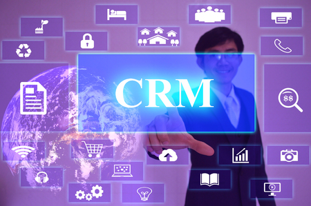 specifying: CRM  concept  presented by  businessman touching on  virtual  screen ,image element furnished by NASA Stock Photo