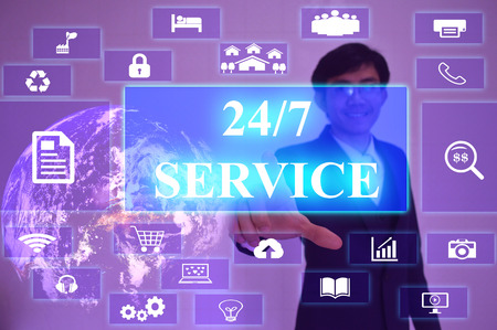 24x7: 247 SERVICE concept  presented by  businessman touching on  virtual  screen Stock Photo